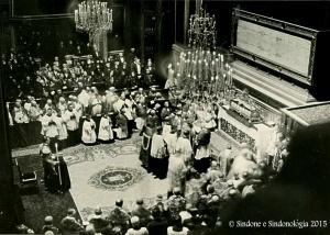 A ceremony in the Cathedral of Turin during the 1931 Exhibition. The officer in uniform on the left, with the candle in his hand, is Prince Humbert of Savoy.